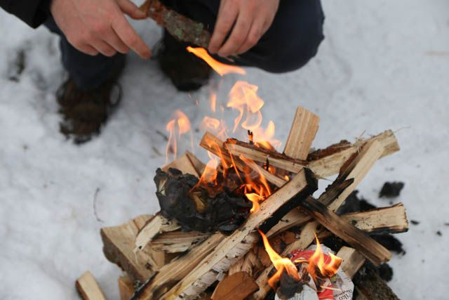 Setting up a fire.