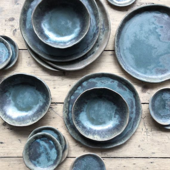 Handmade plates by Illyria Pottery on Etsy.