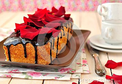 Cake loaf with rose petals by Dolphy, via Dreamstime