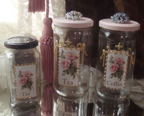 Collage Sheet Girl: Decoupage Jars {This is pretty cool! Now if I can just find things that would store well in all those leftover peanut butter jars...}