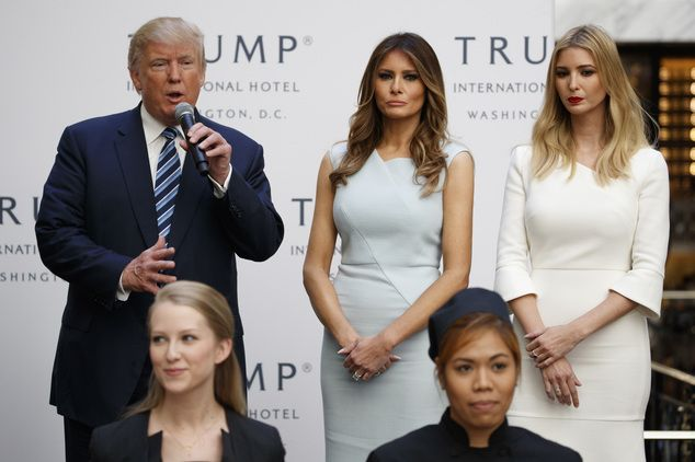 FILE - In this Oct. 26, 2016 file photo, Ivanka Trump, right, and Melania Trump, center, listen as then-Republican presidential candidate Donald Trump speaks...