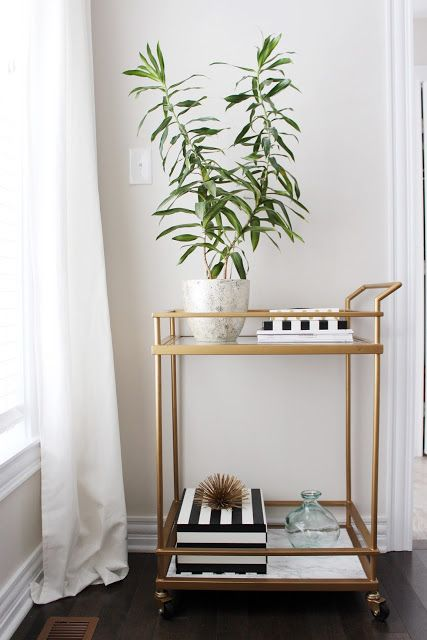 Even though this gold bar cart is chic on its own, adding marble contact paper to the surfaces turns it into something guests will assume cost hundreds of dollars from a high-end designer. Click through for more on this and other genius Target hacks and Target DIYs.