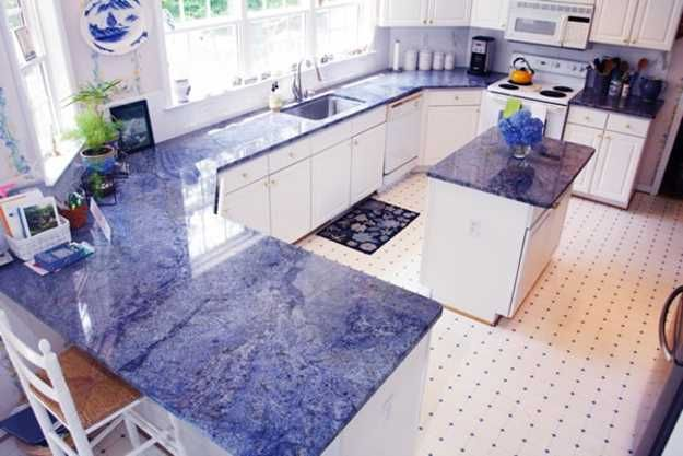 purplish blue and white kitchen cabinets with fkass countertops