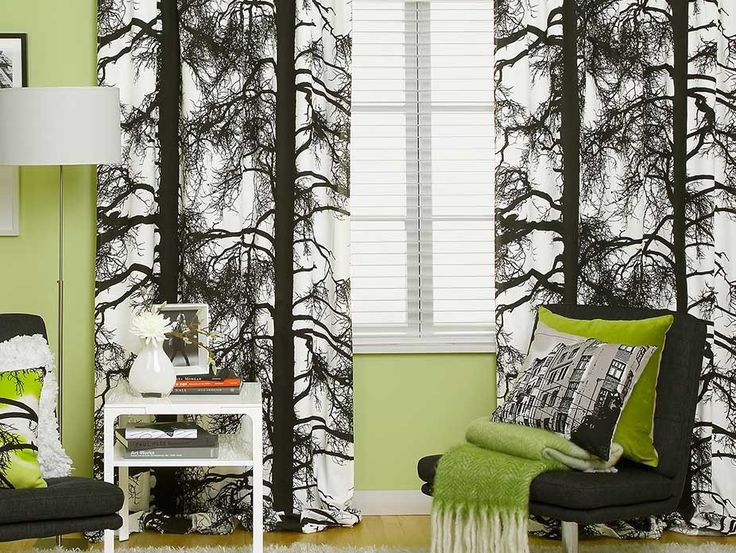 Kelohonka Black & White Fabric - A stunning black tree silhouette creating a subtle vertical stripe design with outspread spidery branches on a white background. Designed by Vallila Interiors of Helsinki and exclusive in NZ to Harvey Furnishings.