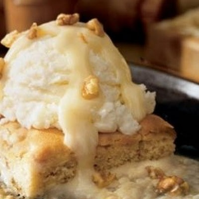 Blondie Brownie with brown sugar sauce add caramel sauce this would be ...