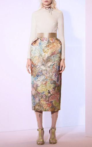 This **Sandra Mansour** skirt features a wide waistband and is rendered in an allover floral brocade fabric.