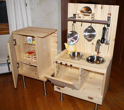 Child's kitchen made from Ikea tables. Cute! I wonder if could do this. Found it on ikeahackers.com