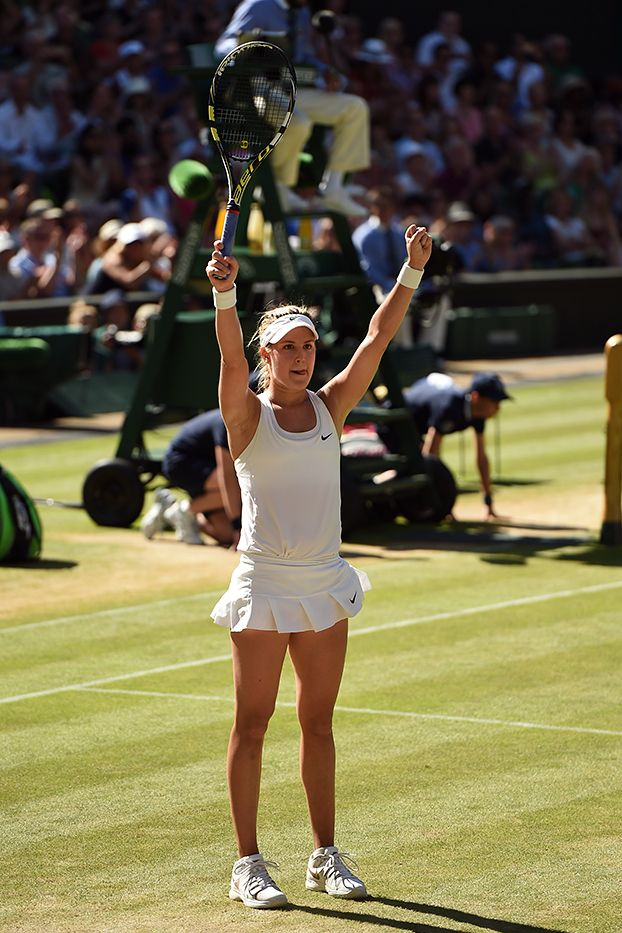 Eugenie Bouchard raises her arms in triumph after her victory over Simona Halep - Billie Weiss/AELTC