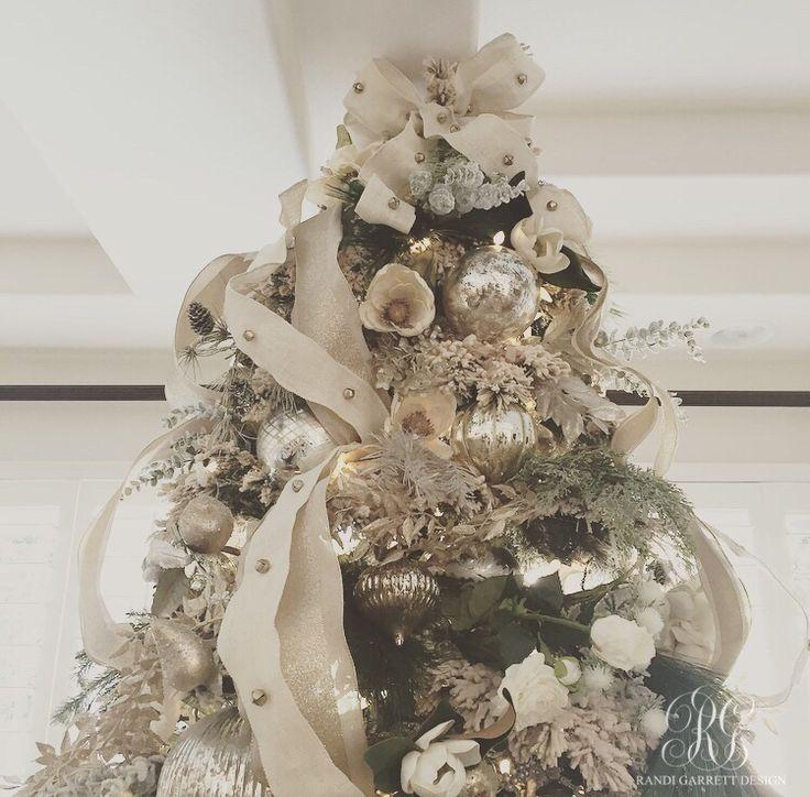 Elegant flocked christmas tree with mercury glass ornaments, magnolias, and jingle bells ribbon