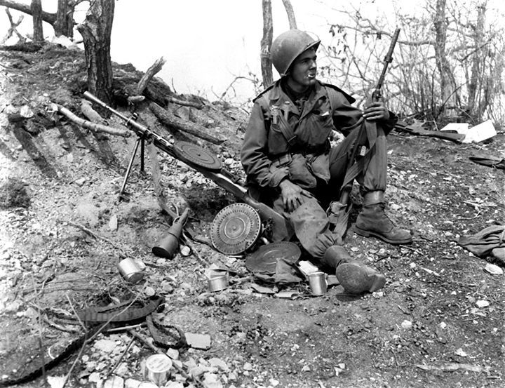 Private First Class Julias Van Den Stock of Company A 32nd Regimental Combat Team US 7th Infantry Division with M1 or M2 Carbine with captured Communist Chinese DP light machine gun on Hill 902 near Ip-Tong Korea 25 AprIL 1951.