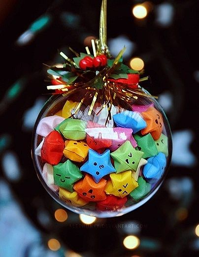 cute lucky star filled christmas tree ornament - my idea is we could do Xmas colours instead and write hopeful messages for the new year in it or wishes for each other and open them the following year