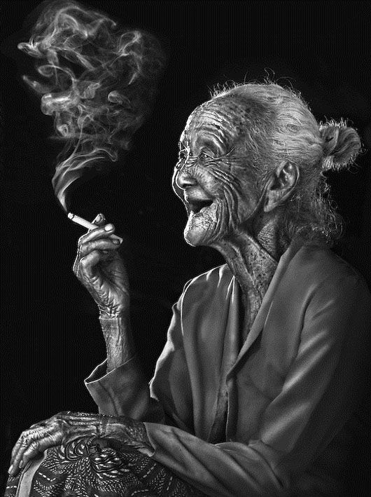 ohh that face totally reminds me of my Great Grandma smoking in her house in Paraguay at 90 years old :)