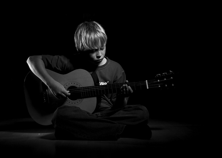 pre-teen boy guitar portrait