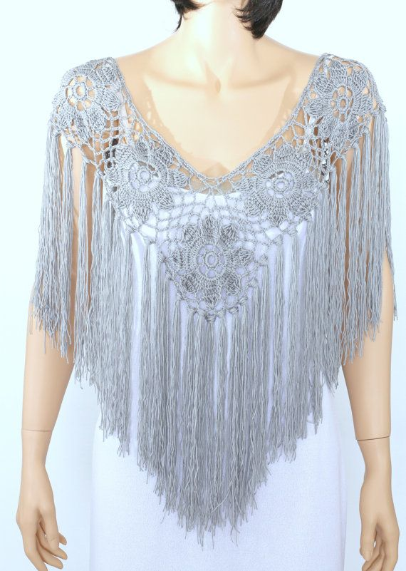 When it comes to accessorizing, boring necklaces are a thing of the past! This delicate handmade poncho is a modern styling option that will set the tone for a stunning ensemble. Designed in artistic detail, it is handmade from fine quality acrylic/cotton yarn blend and features a flower pattern with extra-large fringe accents cascading beneath. You'll want to pair it will a solid colored shirt beneath to truly show off this wondrous creation. As a gift, it makes an impressive choice for...