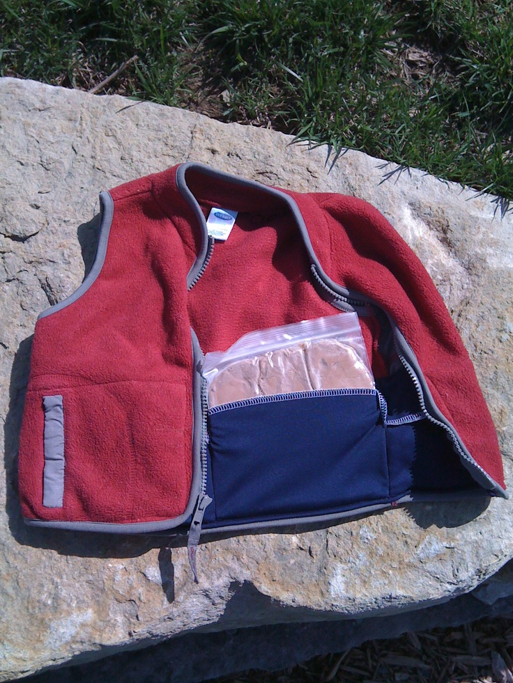 Special Needs weighted vest.  Don't need to spend 60-100 dollars.  This one cost me about $5 to make.  Vest was a 75 cent garage sale find, double knit used for inside pockets (sewed top like overlap pillow back) and weights are sandwich bags and modeling clay.