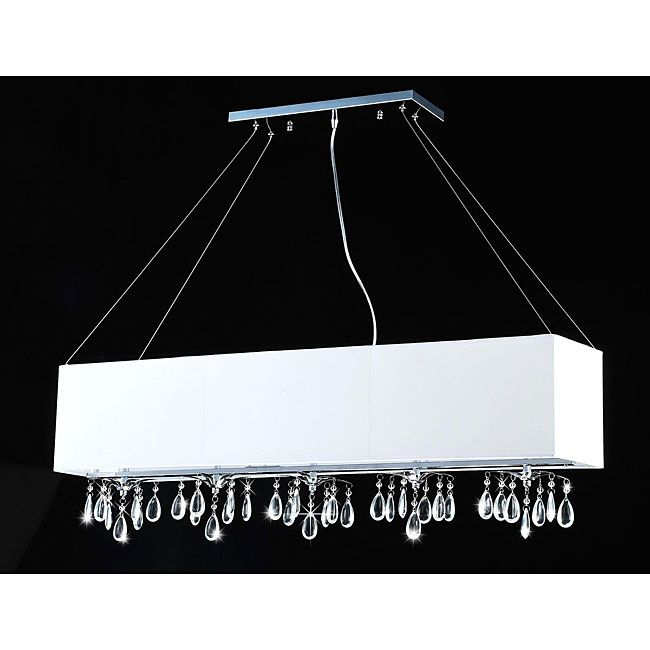 A Unique Rectangular White Shade And Clear Hanging Crystals Adorn This Five Light Chandelier Dining Room