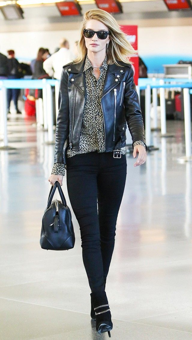 Rosie Huntington-Whiteley in Saint Laurant biker jacket, animal print button-up blouse, and black skinny jeans