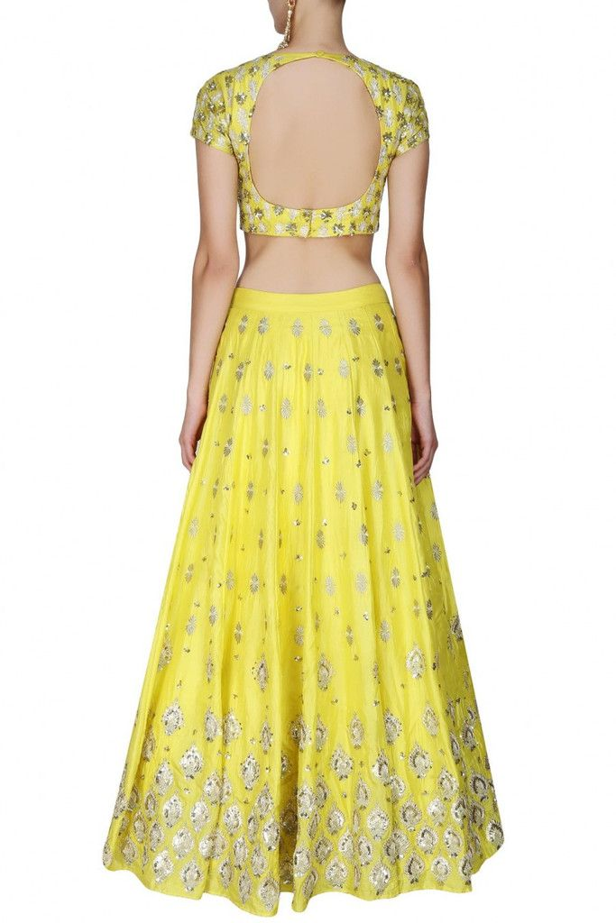 This set features a yellow lehenga in silk base with gold gota and sequins…