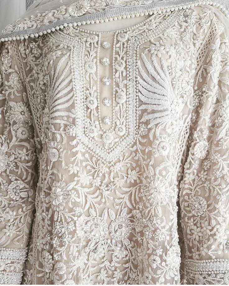 The embroidery on this cream dress is outstanding