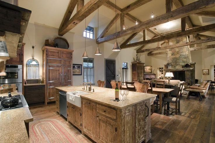 Barndominium interiors kitchen rustic with wood floor strap hinges wood floor  Barn House