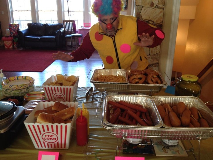 The carnival party food, corndogs, hot dogs, soft pretzels, fries, popcorn