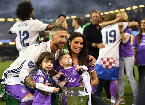 Sergio Ramos of Real Madrid celebrates with his wife and children after victory in the UEFA Champions League Final between Juventus and Real Madrid at National Stadium of Wales on June 3, 2017 in Cardiff, Wales.