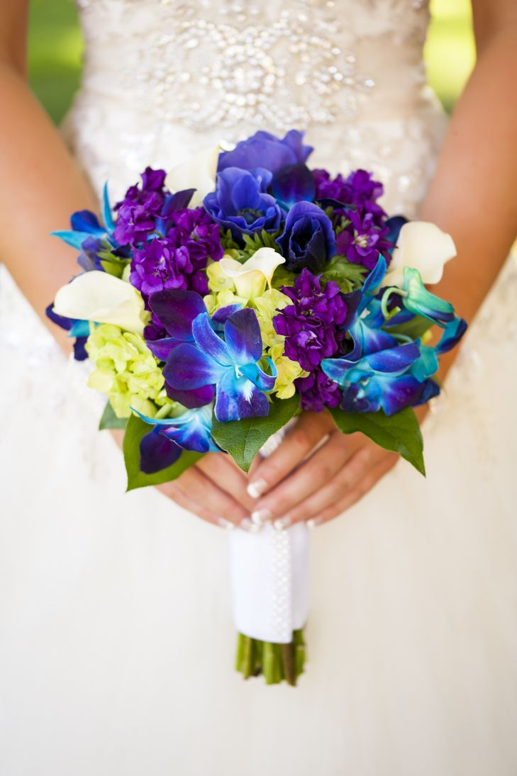 """We loved our flowers because they were very bold and bright and very 'spring' for our March wedding,"" says Landa. Her bouquet consisted of vibrant dendrobium orchids with purple stock, white calla lilies, blue anemones and light green hydrangeas. From A Vibrant Garden Wedding at Secret Garden Event Center in Phoenix, Arizona"
