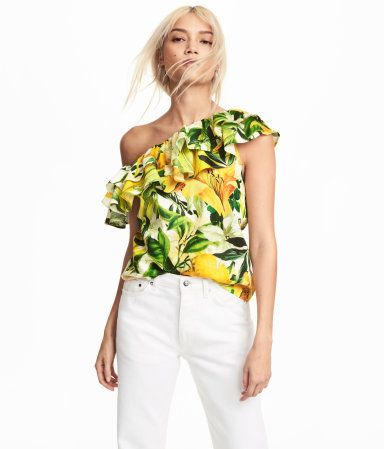 White/yellow patterned. Blouse in woven cotton fabric with a double flounce at top and one short sleeve.