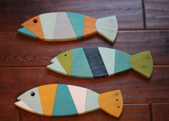 ***HAPPY NEW YEAR SALE***  ***10% OFF ALL ORDERS***  PROMO CODE: NEWYEARS10       These pallet fish measures about 13 1/2 x 3 1/2 in size. It is made of reclaimed pallet wood, and includes hanging clips on the back.  These fish are hand painted and sanded smooth to the touch. I can make these fish in an array of colors. If you would like different colors please leave a note with your color choice when you check out. See image two of the listing for all available colors. Each fish is...