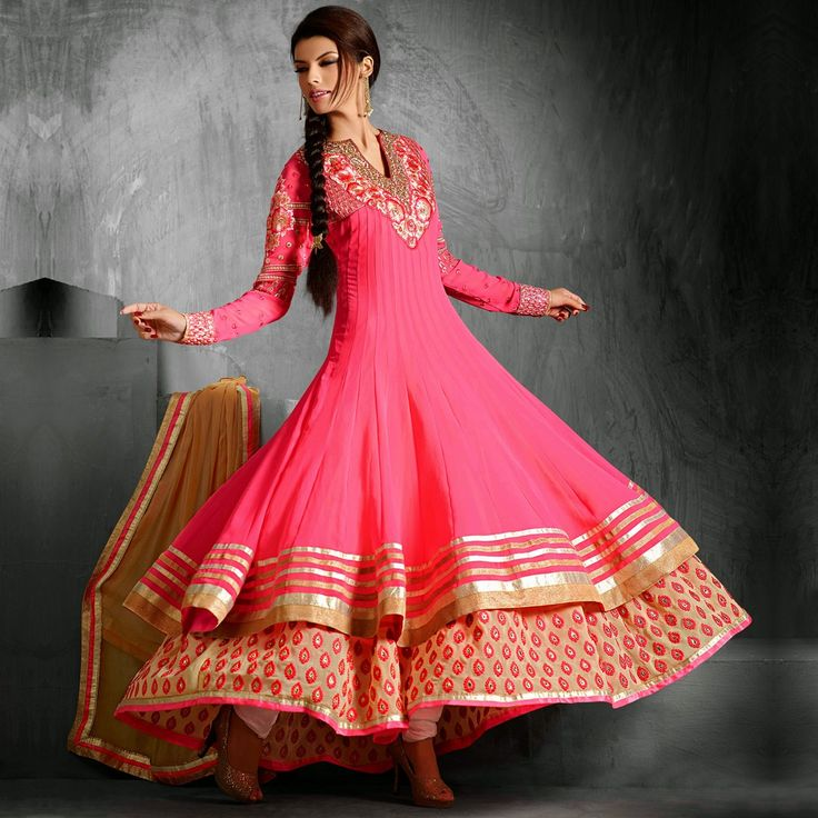 Heart this fuchsia pink number if the double ghera is your first love! This elegant Anarkali will transform your style and create a statement that is elaborate and on trend!