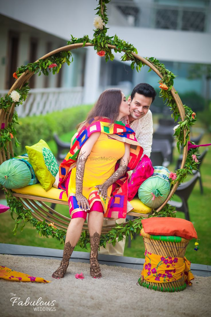 Circular floral and cane swings for mehendi seats | WedMeGood| #wedmegood #indianweddings #floral #swings #mehendiseats #seatings #mehendi #bridal
