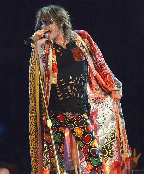 INSPIRATIONAL IMAGE: Steven Tyler. cut shredded T-shirt