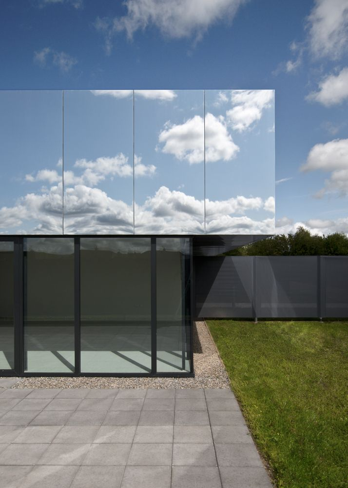 """The structure, designed by Irish firm SATA, has a roof that works as a """"cloaking device"""" and camouflages the building in the right light. It reflects the sky and nearby trees beautifully, but one can easily imagine absent-minded parents cruising right past it on the way to pick up their kids. Click through for more images of this mirrored Irish daycare center."""