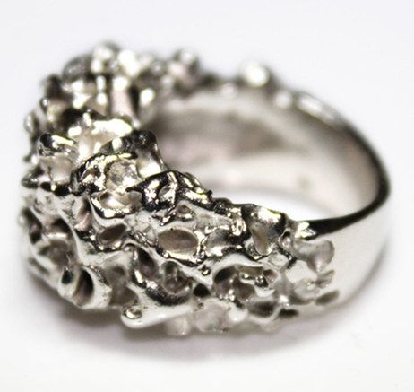 the designer has mixed modern design with functionality to create this impressive ring. £210