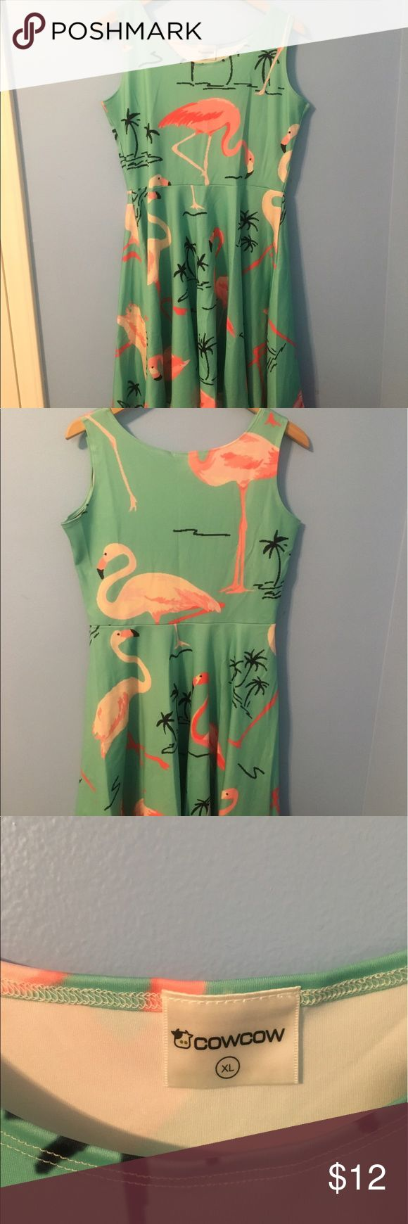 Perfect summer pool party dress!! CowCow flamingo dress. Super stretch. Never worn. 90% polyester, 10% spandex. Easy wash and dry! CowCow Dresses