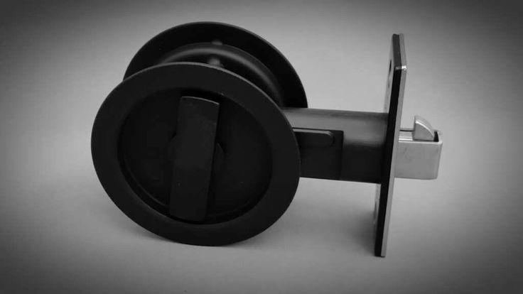 Matte black round cavity sliding door lock from thelockandhandle.com