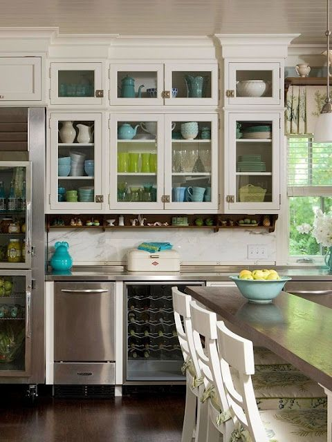 I love all the green and turquoise dishes in the glass-fronted cabinets