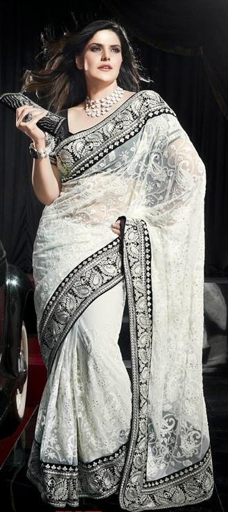 101915 #LakmeFashionWeek #ManishMalhotra's Monochrome magic in border. Get similar trend with this saree.