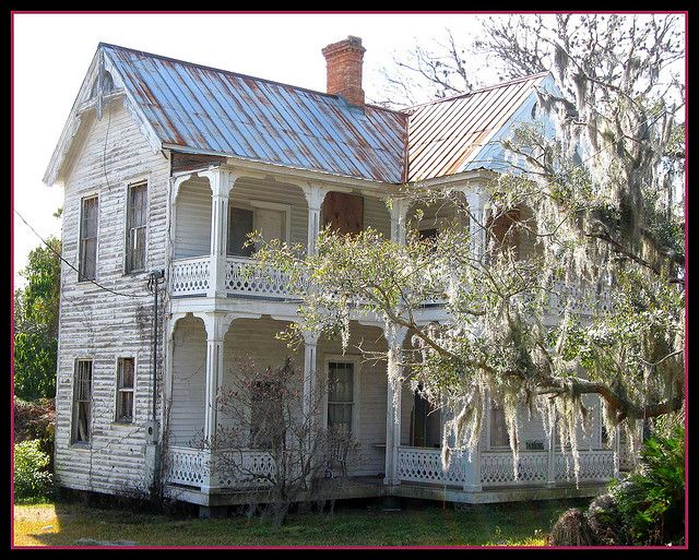 Old home with two floors of great old porches ~ could raise an old Queenslander and do this :)
