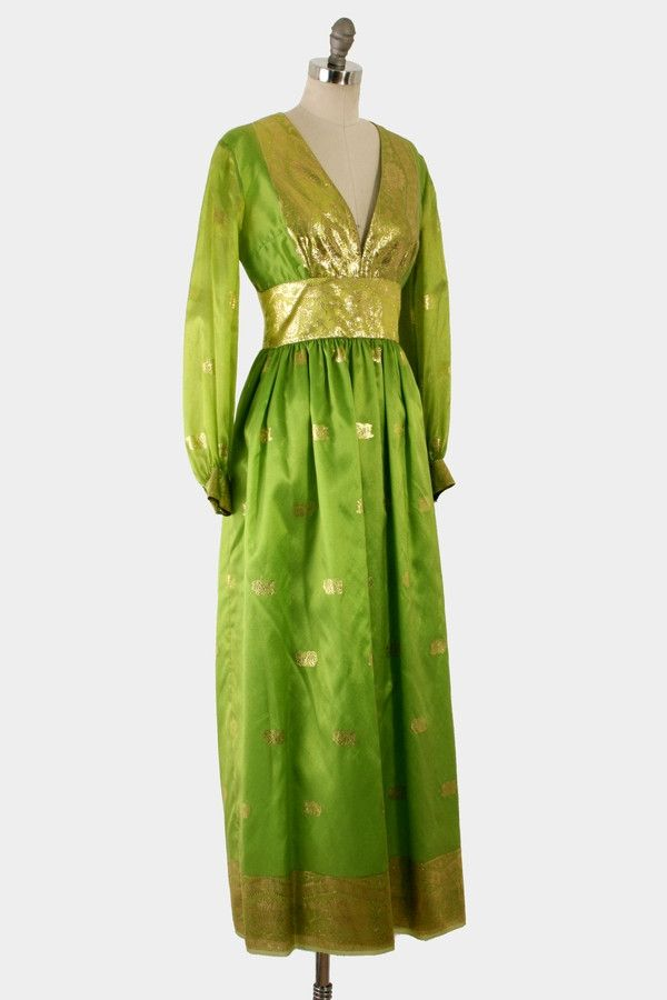 Vintage 1960's or early 1970's sari material maxi dress. This gorgeous dress was handmade by a tailor in the late 1960's or early 1970's. It was a gift to one of her children's teachers. We purchased