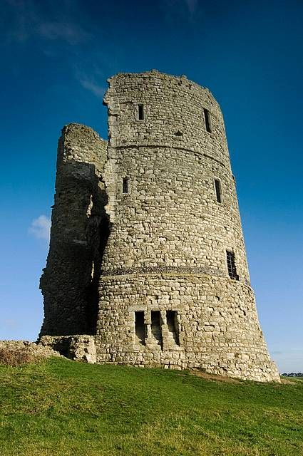 The romantic ruins of a royal castle overlooking the Essex marshes. Hadleigh was begun in about 1215 by Hubert de Burgh, but extensively refortified by Edward III during the Hundred Years War, becoming a favourite residence of the ageing king.     The barbican and two striking drum towers – one later used by Georgian revenue men looking out for smugglers – are part of his substantial building works during the 1360s.  via English Heritage
