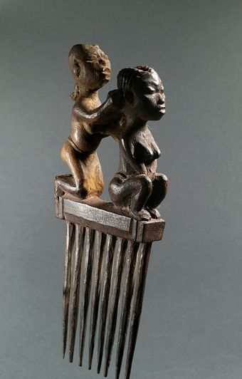 West African vintage wooden comb, with the handle depicting a hairdressing…