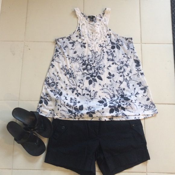 H&M top Black floral design H&M tank top . Super cute like new no holes or tears. Lace in front . H&M Tops Tank Tops