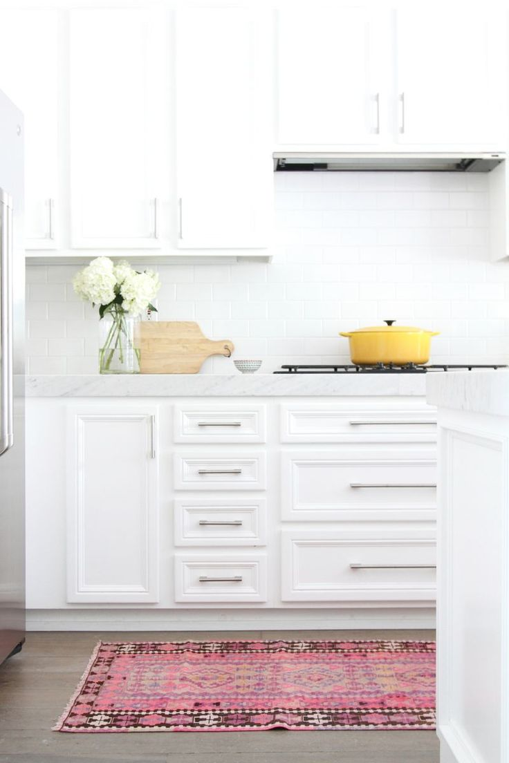 gorgeous white kitchen with pops of color