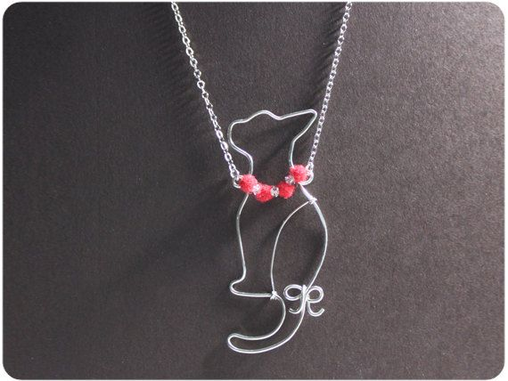 Cat w/ red necklace,  Necklace - wire, crystal beads, wool felt. $16.00, via Etsy.