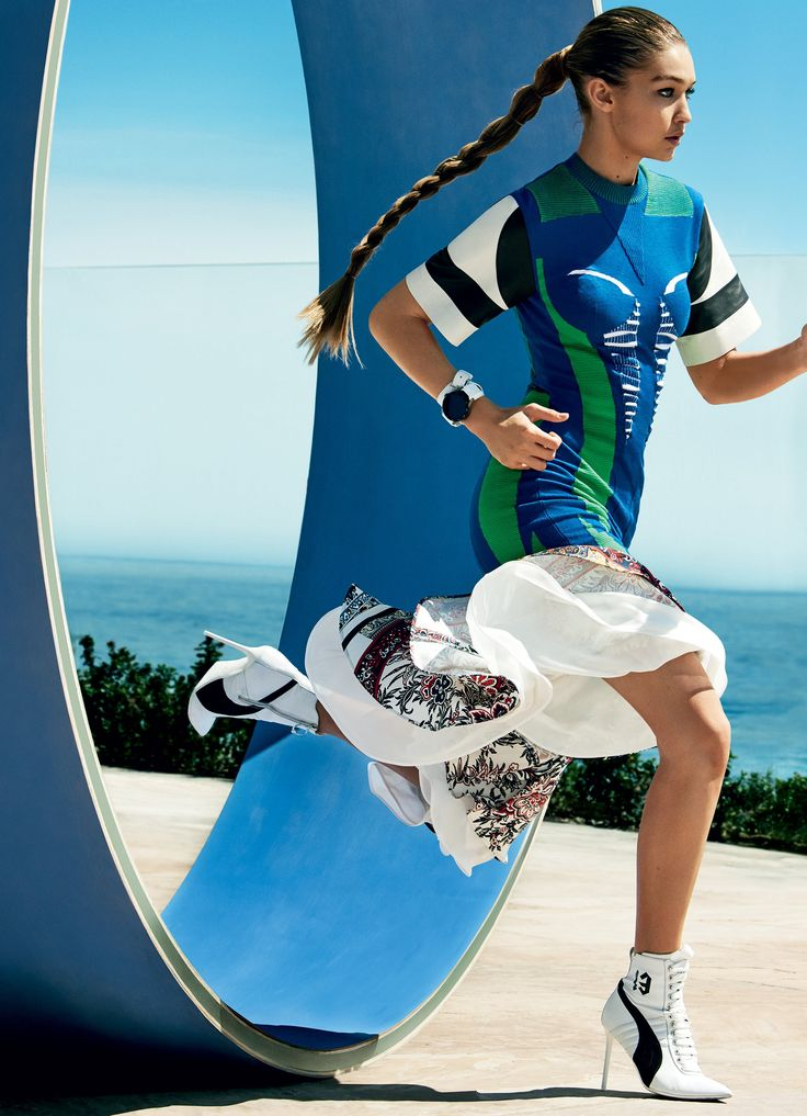 A Running Start - Hadid is an avid swimmer, volleyballer, and equestrian. Her father skied the downhill at Albertville in '92—and she once thought she might become an Olympian herself. Louis Vuitton leather-sleeved tech-knit dress and asymmetric skirt; select Louis Vuitton boutiques. Hermès bracelet. TAG Heuer watch.