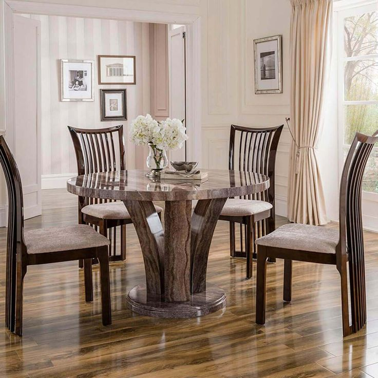 The Amalfi Pearl Grey Round Marble Dining Set is the perfect addition for those who like to host dinner parties or simply enjoy high-quality luxury. Crafted from a smooth marble and finished in a unique pearl grey, the Amalfi dining set will transform your home and provide a beautiful design that you will love for many years to come. Pearl grey marble Unique base design Available with 4 chairs Slatted back chairs Stone fabric seat pads The stunning Amalfi marble dining set fe