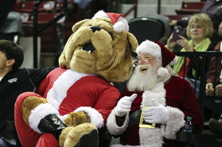 Mississippi State Bulldogs mascot Bully shares a laugh with Santa Claus at a MSU basketball game.