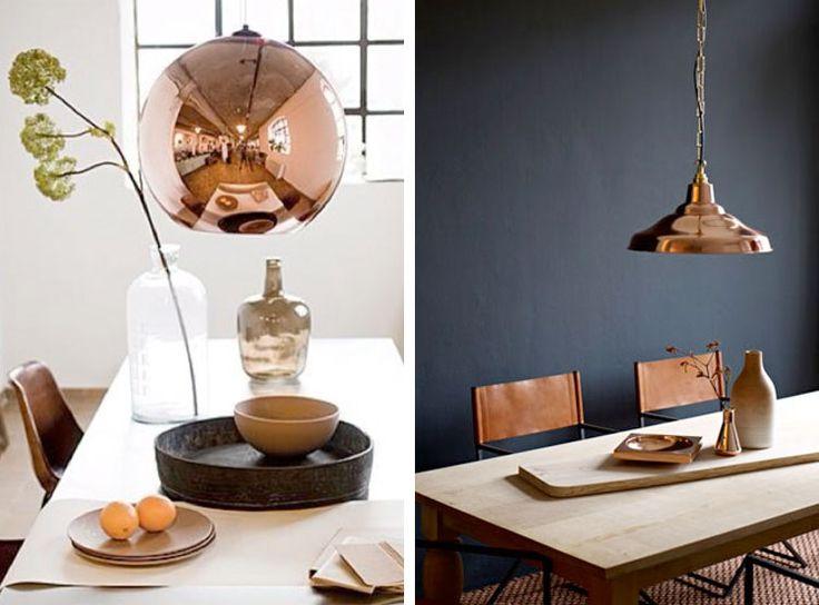 Koperen lampen boven de eettafel | Woonguide.nl