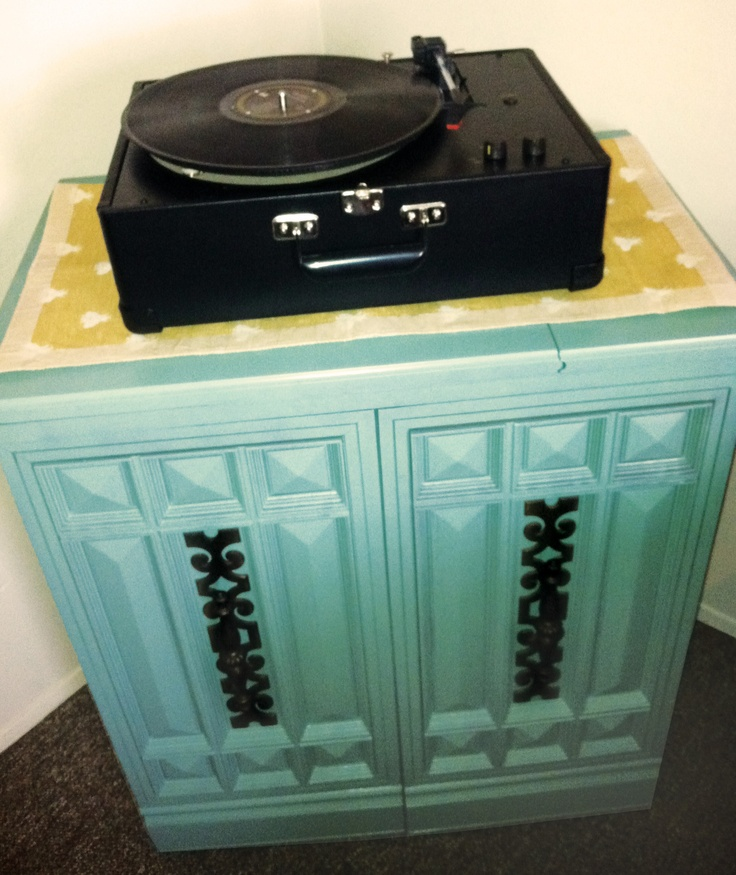 our version of a record player table. we found an old sewing cabinet at a local thrift store for $12 and then spray painted it jade. amazing transformation for under $20. #recordplayertable, #sewingcabinet